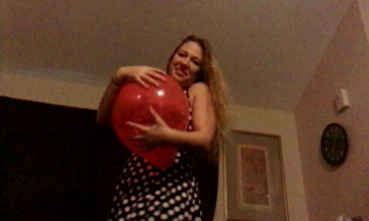 Eve Batelle Squeezing Hug To Pop Balloon