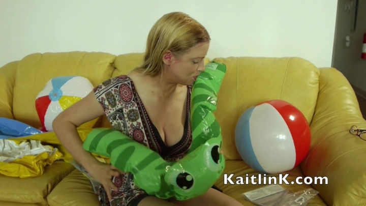 Kaitlink Blowing Up A Green Frog Pool Toy